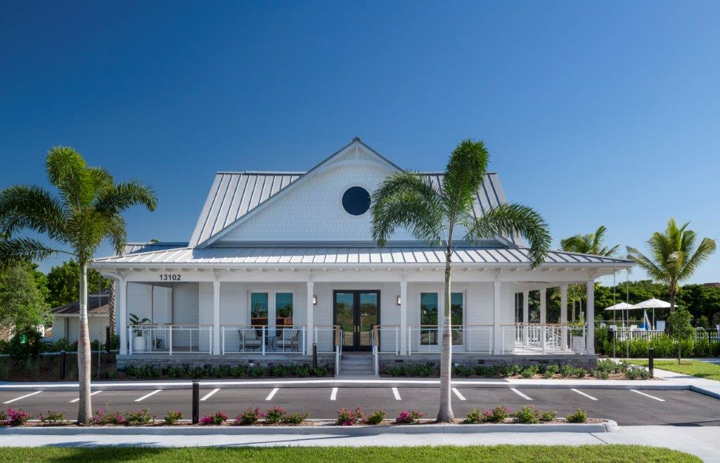 A community center featuring old-Florida style architecture stands at the entrance of The Enclave neighborhood at Shell Point.